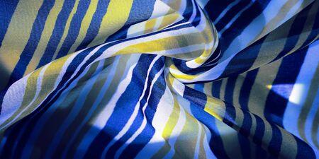 背景纹理。多彩多姿的条纹丝绸面料。墨西哥着色主题明亮色的条纹图案与抽象条纹