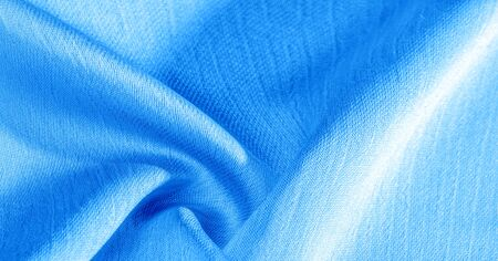 Background, pattern, texture, wallpaper, blue silk fabric. It has a smooth matte finish. Use this luxurious fabric for anything - from design to your projects. The possibilities are truly endless!
