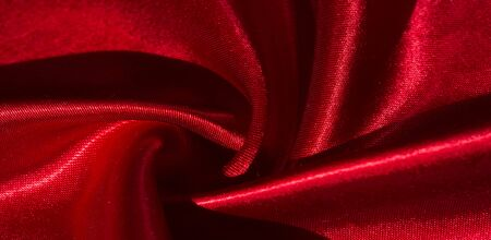 texture, background, pattern, silk fabric of red color. This adorable, soft and shiny fabric has a smooth mink surface ideal for creating your projects. Archivio Fotografico
