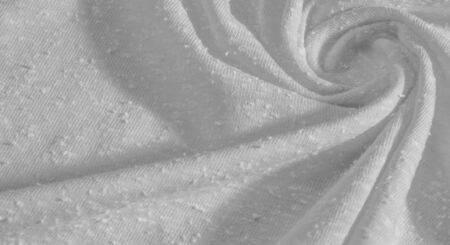 background, pattern, texture, ornament, vintage. white fabric with artificial granules. pellet roll. This high-quality, lightweight, stretch cotton fabric with smooth arm Stock Photo