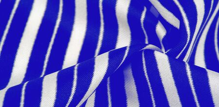 silk striped fabric. blue white stripes. This beautiful, super soft, medium-sized silk blend is perfect for your design projects. It is brushed on the back for a luxurious feeling.