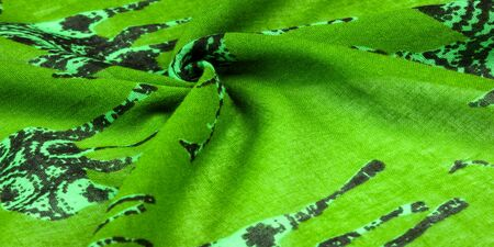 texture, background, cotton fabric of green color with a print of deer silhouettes, expensive thin fabric will become the leader of your projects, modern Futuristic Fine Art, Banco de Imagens