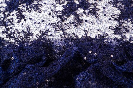 Texture, pattern, lace blue on a white background. Delicate and classic, this sheer lace has no significant stretch and pearlescent shine. This lace fabric is suitable for your design, Stock fotó