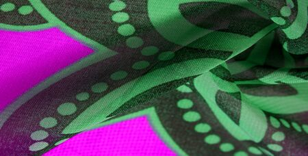 texture background pattern wallpaper. Green pink black silk fabric pattern. This medium-weight rayon fabric has a nice shine with slight color variations. Perfect for adding elegance to your designs