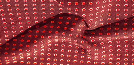 Texture background, pattern, red silk fabric with red polka dots. Light and silky-soft satin pendant is perfect for your design, online projects. It is also perfect for screensavers and wallpapers Фото со стока