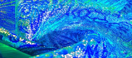 Texture background, pattern. blue brocade fabric. Organza brocade fabric - shepherd, with a crunchy palm. It has a large yarn-dyed flower embroidered pattern throughout.