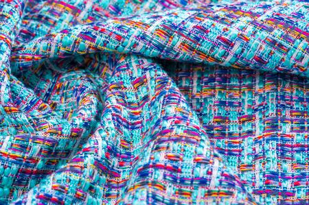 Background texture, pattern. Winter fabric, warm. big braided thread. Blue-red yellow threads. This photo will make your design the best. Wallpapers, pictures, posters.