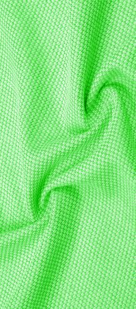 Background texture, pattern Fabric warm wool with a stitched green thread. For those influenced by the classics, grab yourself this vintage-inspired hue blends with olive, green and emerald Stockfoto