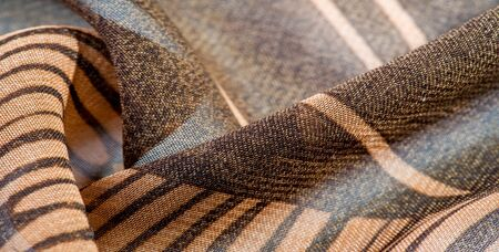 texture, background, pattern, wallpaper. brown silk fabric pattern. This medium-weight rayon fabric has a nice shine with slight color variations. Perfect for adding elegance to your designs.