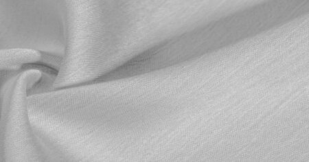 Background, pattern, texture, wallpaper, white silk fabric. It has a smooth matte finish. Use this luxurious fabric for anything - from design to your projects. The possibilities are truly endless!