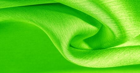 Background, pattern, texture, wallpaper, green silk fabric. It has a smooth matte finish. Use this luxurious fabric for anything - from design to your projects. The possibilities are truly endless!