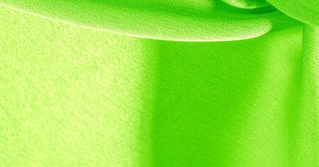 Background, pattern, texture, wallpaper, green silk fabric. It has a smooth matte finish. Use this luxurious fabric for anything - from design to your projects. The possibilities are truly endless! Stock fotó
