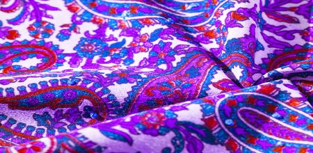 Background texture, pattern, paisley fabric cotton.  Designed by Kaffe Fassett for Free Spirit, the color palette of this large paisley is shades of green with hot pink, cobalt blue, fuchsia and purple.