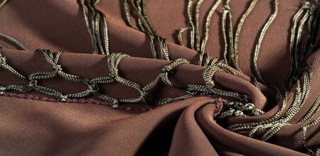 Background texture of silk fabric. This is a natural brown scarf, this beautiful nylon satin made of artificial silk with a clear hand and a wonderful sheen is perfect for your projects. Stock Photo