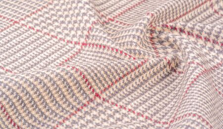 Background texture, pattern. The fabric is thick, warm in a cage, beige. This is 100% wool terry dressing. Sinil has a soft pile and is very versatile. It fits your design. Stockfoto