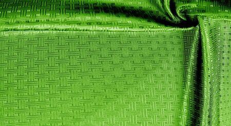 Background texture green silk fabric with a small checkered pattern. When you take home this green orchid brocade. Adding a 3D view to brocade. Thin and light, its flexible drape falls on some volume Reklamní fotografie