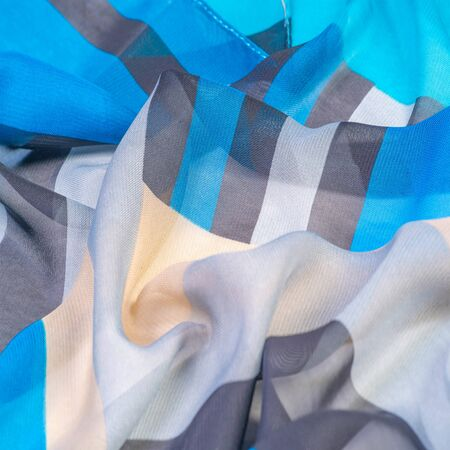 Texture, background, silk fabric pattern, oblong rhombus, bohemian print, decorative fabric for your design and project accents, multicolor Grunge blue azure beige gray 免版税图像