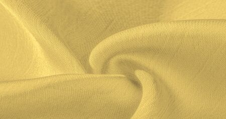 Background, pattern, texture, wallpaper, yellow silk fabric. It has a smooth matte finish. Use this luxurious fabric for anything - from design to your projects. The possibilities are truly endless! Stock fotó