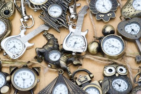 Flea market, small products of metal. a market, typically outdoors, selling secondhand goods.