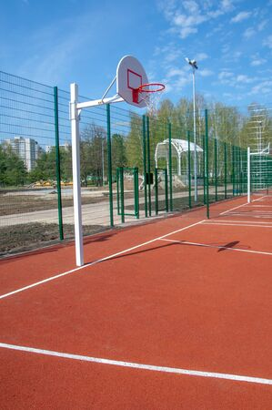 rubberized playgrounds, basketball court - This is a playing surface consisting of a rectangular floor, with baskets at each end.