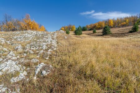 Autumn photos of the Crimean peninsula, Mount Demerdzhi, the famous Crimean landmark. This place is interesting for unusual extracts that give rise to the forces of nature: wind rains and earthquakes