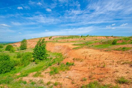 Summer photography, landscape with red clay slide