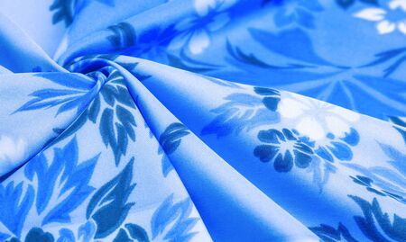 texture, background, pattern, delicate blue silk with floral print Exceptionally lightweight pure silk fabric with a delicate texture. Clean, use lining when opacity is desired. Reklamní fotografie