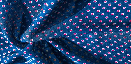 Texture background, pattern, blue silk fabric with red polka dots. Light and silky-soft satin pendant is perfect for your design, online projects. It is also perfect for screensavers and wallpapers.