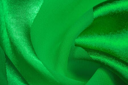 Texture, background, green silk striped fabric with a metallic sheen. If you have a bad mood, this fabric will lift it to unprecedented heights. Your project will be successful.