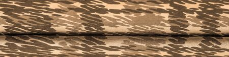 Background design texture, sandy sepia yellow silk fabric, abstraction, copyright print, military camouflage fleece fabric, your designs will allow you to be military, 免版税图像