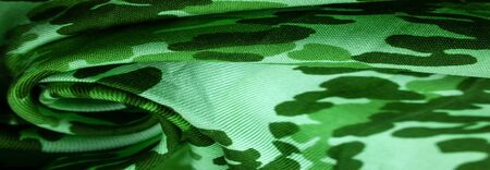 Background design texture, green silk fabric, abstraction, copyright print, military camouflage fleece fabric, your designs will allow you to be military,