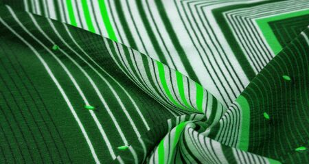 Textural pattern, collection, silk fabric, green background with a striped pattern of white and salad lines, Spanish theme, Mexican costumes poncho