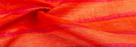 Texture, background, pattern, design, fabric red-orange with yellow stripes, This bold and bright fabric for your projects. With many soft plains in a huge variety of colors Stockfoto