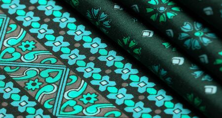 silk fabric of green color with blue and white flowers, dense fabric, bilateral on the basis of triacetate fibers. Texture, Background, Pattern, Decor, Modern, Textile, Art, Design,