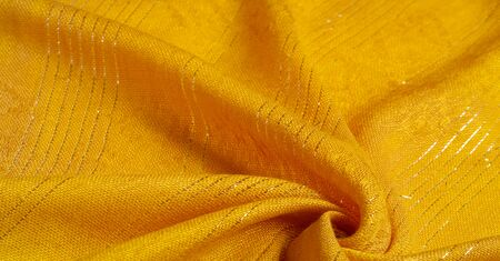 Texture, background, pattern, yellow gold fabric with glitter inserted, yellow strip of golden krypton stripes, designer fabric