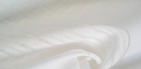 texture silk white fabric. From Telio, this organza has a thin, open weave that is thicker and sharper than silk gauze. Use this luxurious fabric for anything. The possibilities are really endless!