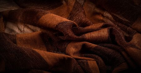 Texture, background, design, light transparent silk fabric in brown, Soft-touch material is available in a rainbow of colors to blend with the latest developments of your projects Stockfoto