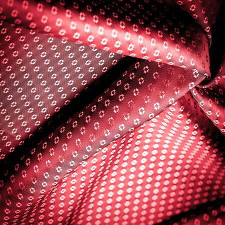 Background texture, ruby red color of the fabric is thin, strong, soft, shiny fiber obtained by silkworms in the manufacture of cocoons and assembled for the manufacture of threads and fabrics.