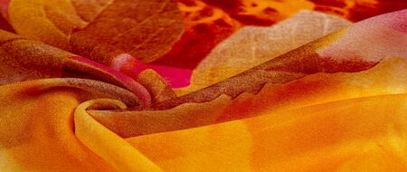Texture, background, pattern, postcard, silk fabric, female color scarf with yellow red-brown colors. The gorgeous design is based on attractive background images. You will be the best