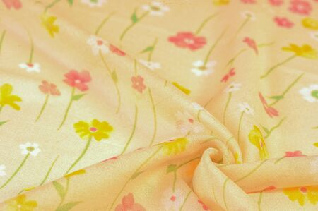 Texture background, silk fabric, small flowers on a beige background, Thin stitch. Red, beige tone print. Flower design
