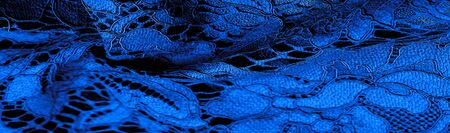 Texture, background, pattern, blue lace fabric, delicate embossed lace fabric, scalloped on both edges. Suitable for your projects, design, etc.
