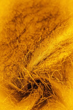 Background texture, decorative ornament, yellow gold silk fabric, woven threads on the fabric, fluffy effect, sensation, appearance or texture of a surface or substance,
