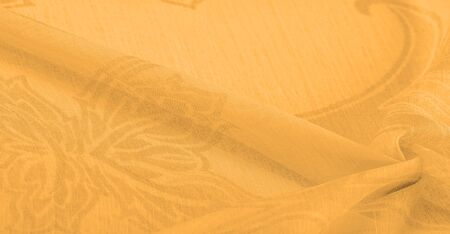 Texture, background, pattern, sensation, cambric - very thin translucent soft mercerized fabric, amber yellow