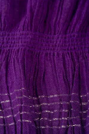 Texture background pattern, decor ornament, dark lilac corrugated fabric of blue cent, Fabric with parallel or diagonal folds of dentate folds; products from such a fabric.