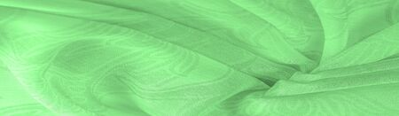 Texture, background, pattern, sensation, cambric - very thin translucent soft mercerized fabric, green magic mint