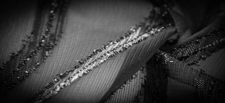 The texture of the background image, the fabric is transparent with brightly congenital stripes, material, allowing the light to pass through it so that the objects behind are clearly visible.