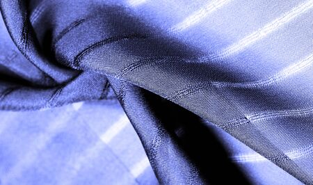 Texture, background, pattern, simple blue fabric with lines. The lines formed by the extraction of the thread,