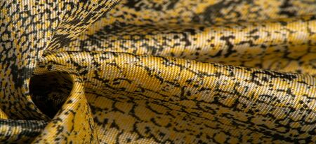 Texture, background, pattern, fabric with a pattern of yellow snake skin, African fabric, designer photo - safari in the country of Africa