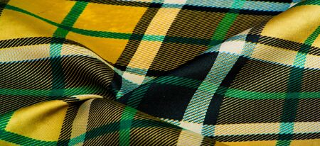 Texture, background, pattern, checkered fabric, yellow-green-white-blue colors, Scottish motifs in this fabric, your design with the sounds of bagpipes and fragrant whiskey Archivio Fotografico