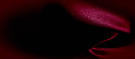 texture, red silk fabric panoramic photo. Silk Duke mood satin - beautiful and regal. It has a darker luster, then the usual satin on the one hand, has an average weight and has a more solid hand. Stock fotó